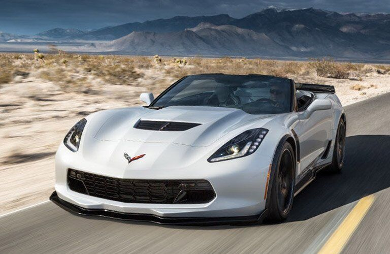attractive 2017 Chevy Corvette Stingray driving through the desert