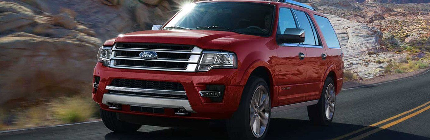 2017 Ford Expedition exterior front fascia and drivers side driving on rocky road