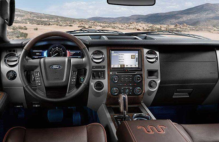 2017 Ford Expedition interior front cabin steering wheel and dashboard in desert