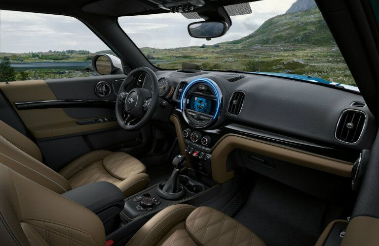 Leather appointed interior of 2018 MINI Cooper Countryman with steering wheel and center touchscreen