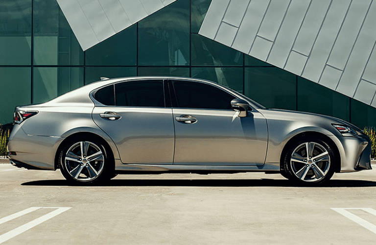 Profile view of Lexus GS in front of modern-styled building