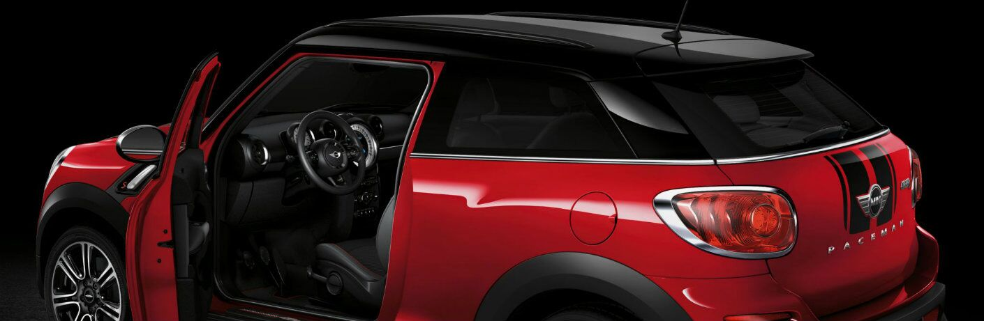 Red Mini Cooper Paceman parked with the driver door open