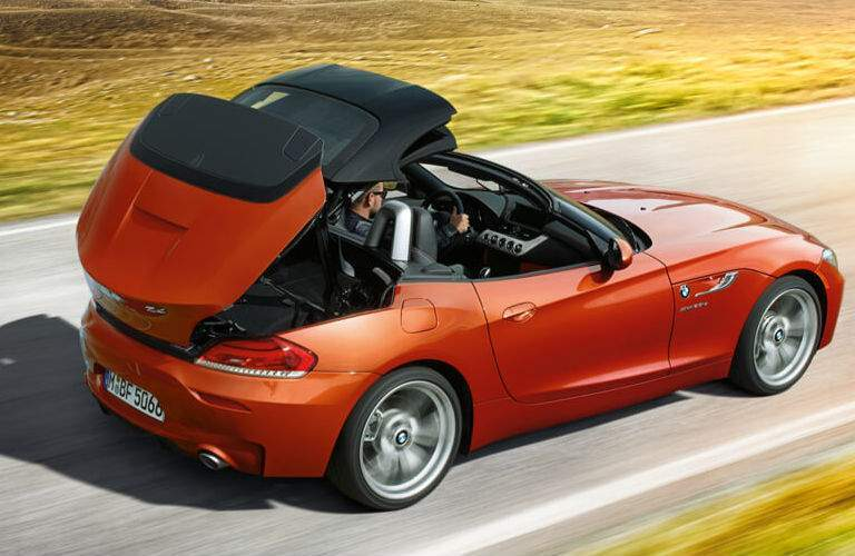 2014 BMW Z4 exterior back fascia and passenger side with top folding back