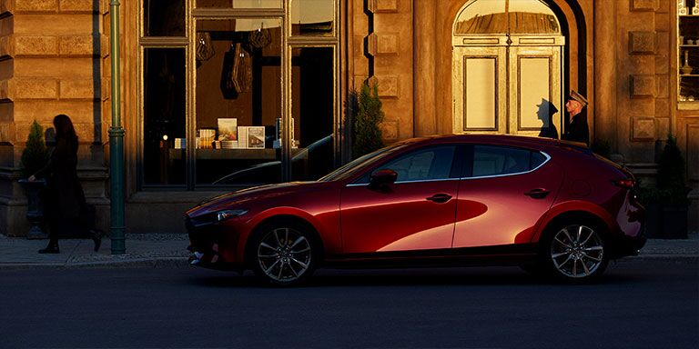 2019 Mazda3 Hatchback parked in front of a building