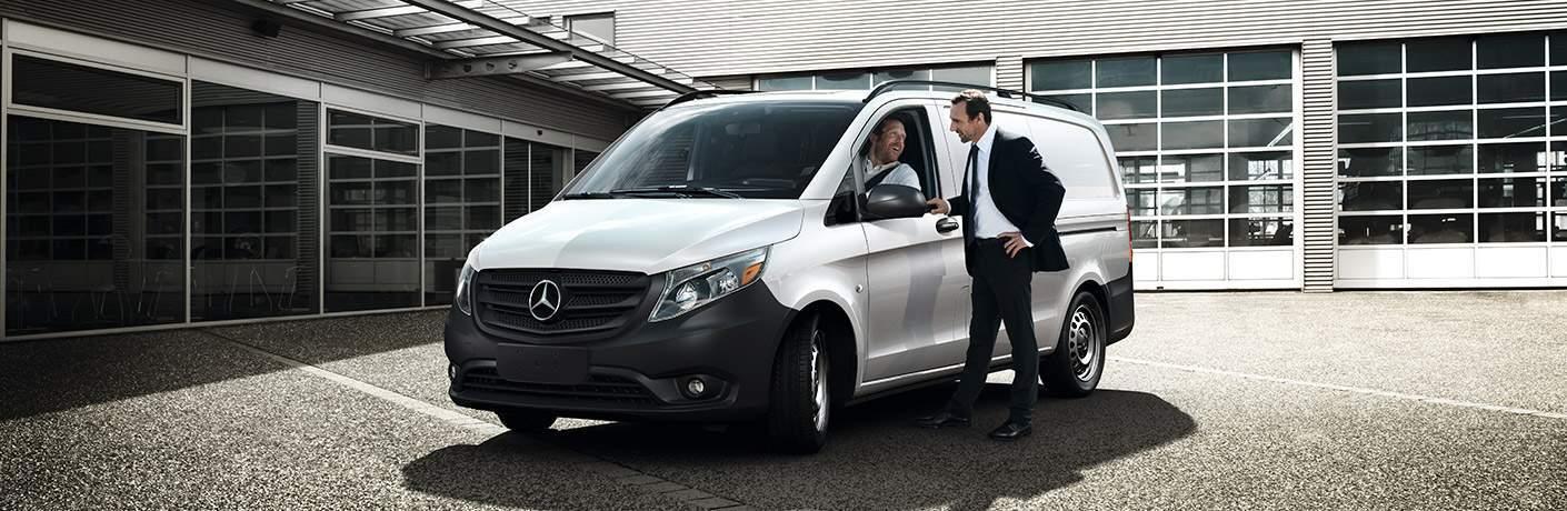 2017 mercedes-benz metris van parked with two men talking