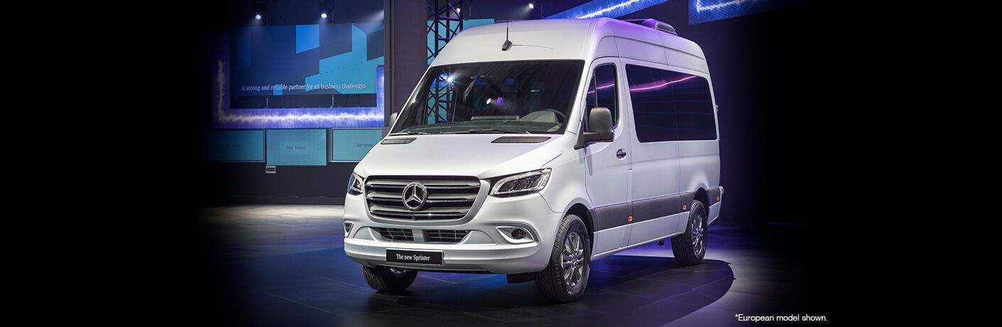 white 2018 mercedes-benz cargo van in black room