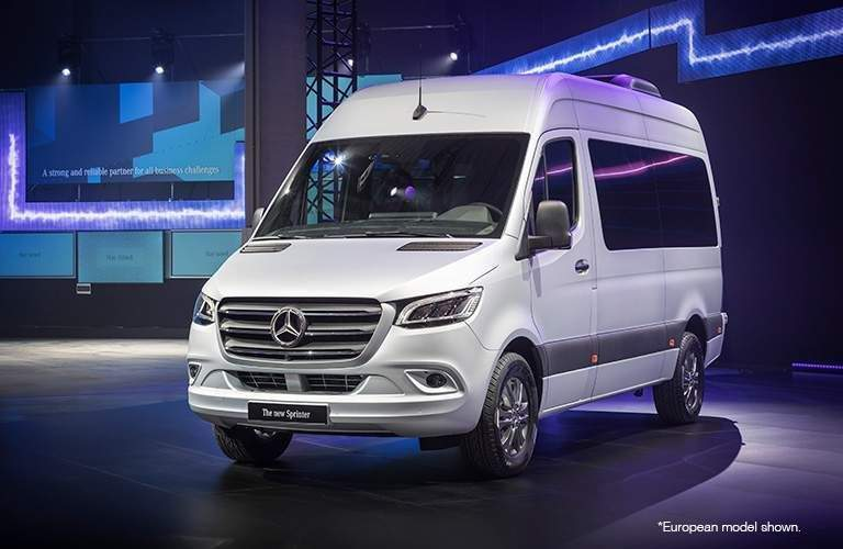 white 2018 mercedes-benz cargo van in lit up room