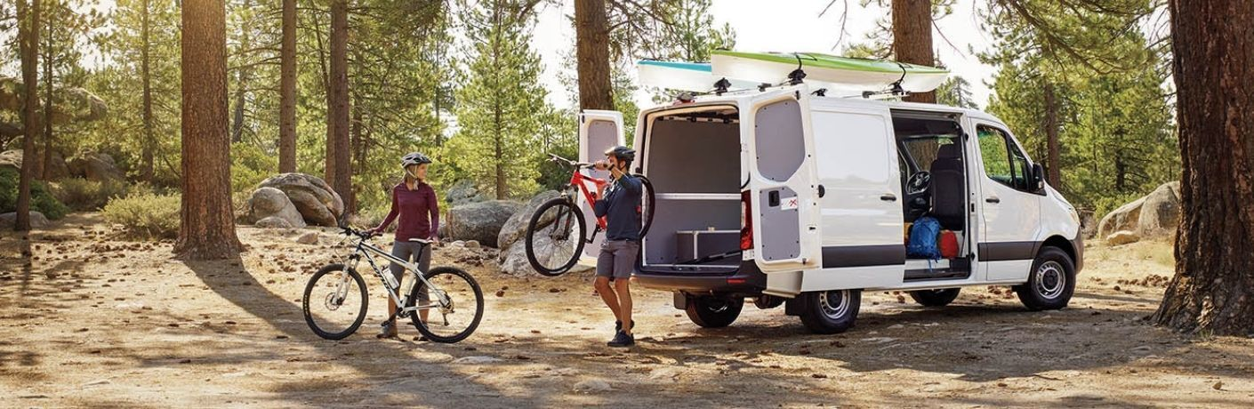 bicyclists unloading from 2020 Mercedes-Benz Sprinter 3500 Cargo Van in the woods
