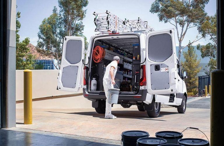 man unloading buckets from 2020 Mercedes-Benz Sprinter 3500 Cargo Van