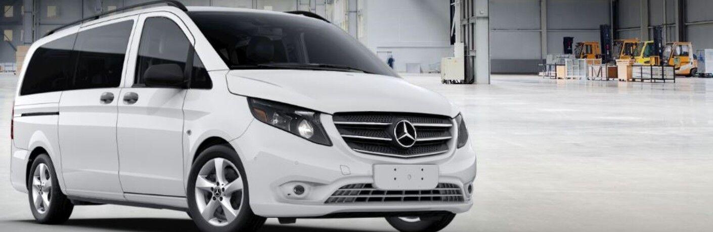 white mercedes-benz metris passenger van front view