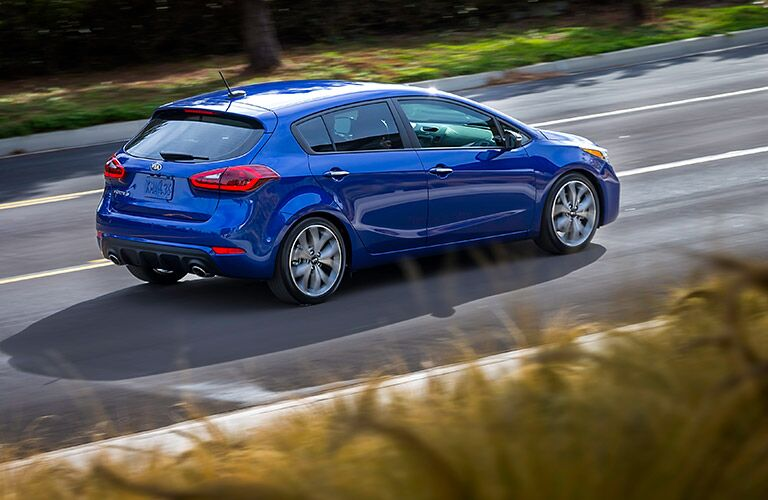Blue 2017 Kia Forte5 Rear Exterior on the Road
