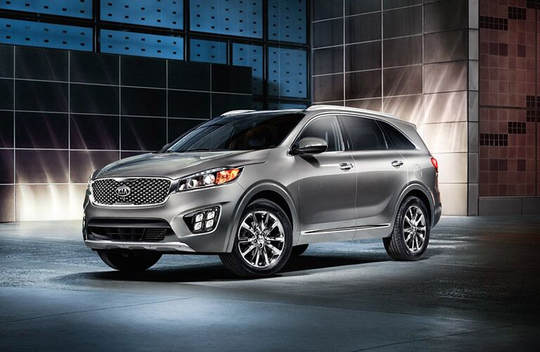 Gray 2017 Kia Sorento Front and Side Exterior in front of glass building