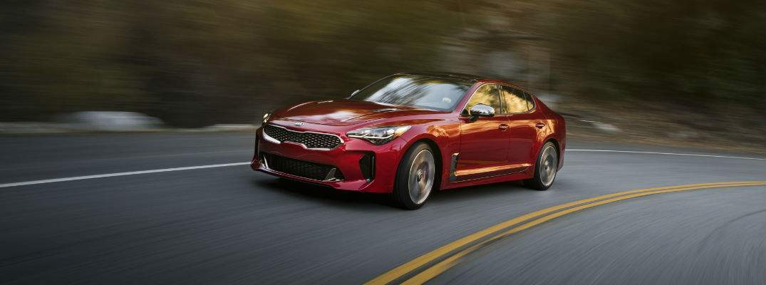 2018 Kia Stinger in Red driving around a curve