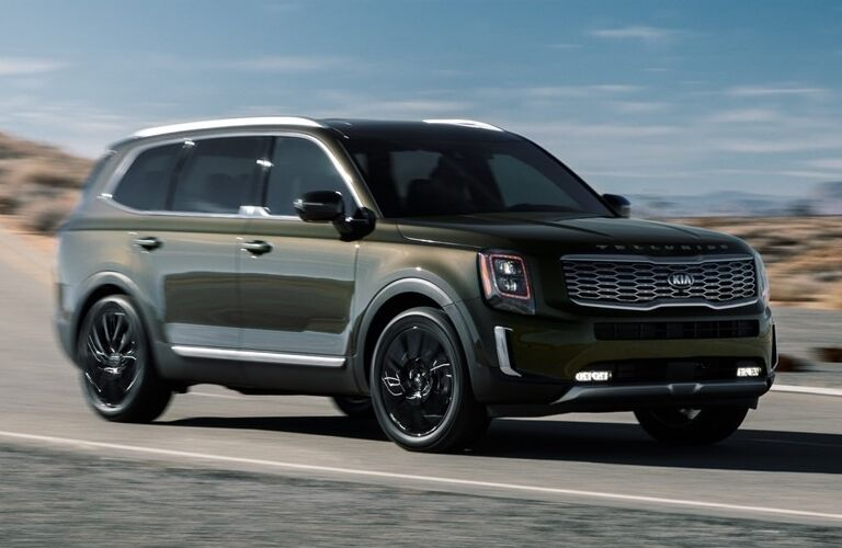Front view of Dark Moss 2020 Kia Telluride on the road