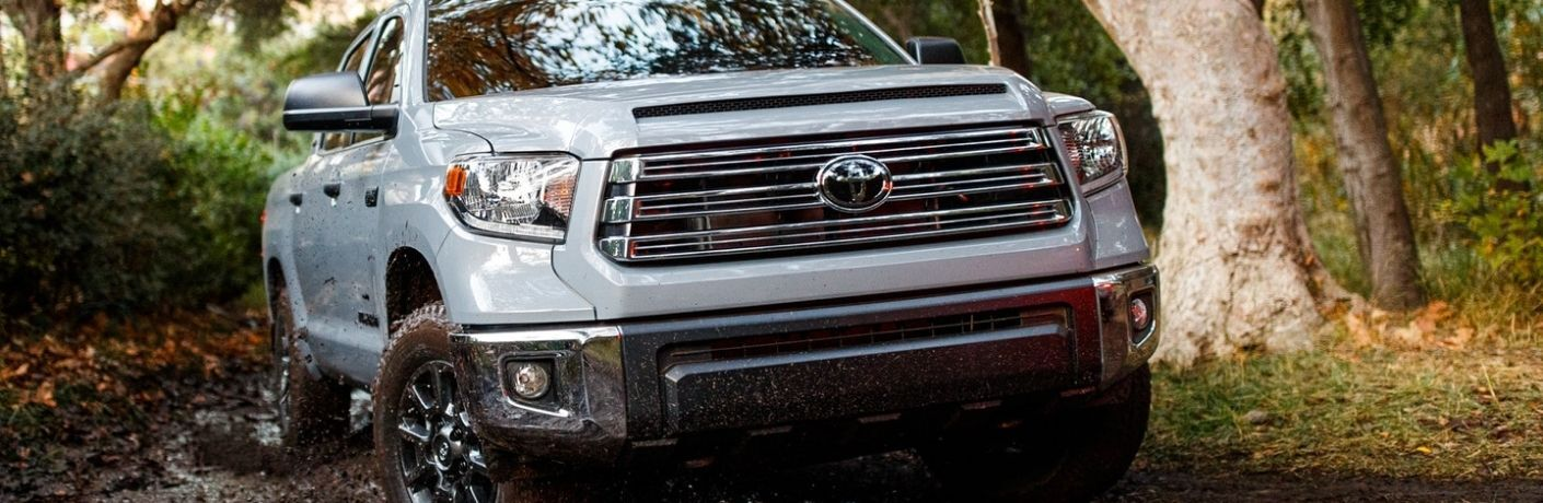 front view of a Toyota truck in mud