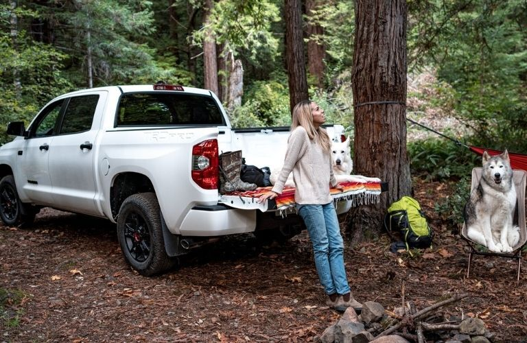 woman standing near the trunk of a Toyota truck
