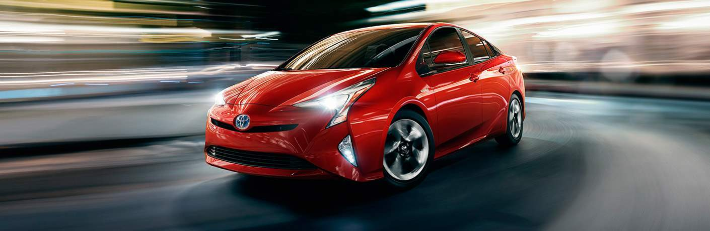 red 2017 Toyota Prius driving on curve