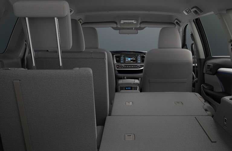 Rear seats of the 2018 Toyota Highlander folded flat for passenger and cargo versatility