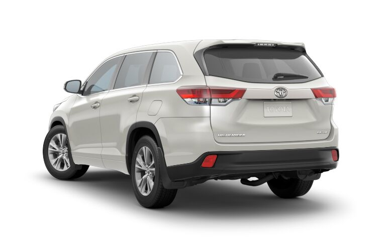 Rear exterior view of a white 2018 Toyota Highlander