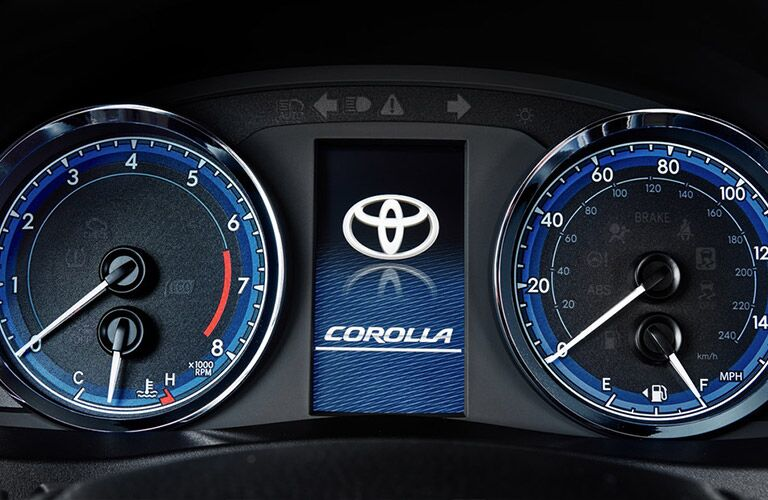 2019 Toyota Corolla interior close up of sport gauge cluster with Toyota Corolla badge screen