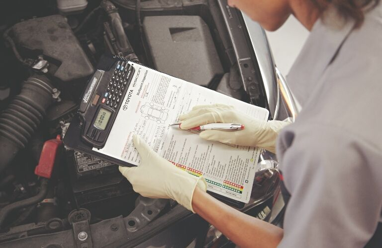 Toyota tech with a checklist