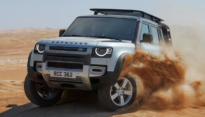 Land Rover Defender driving through sand