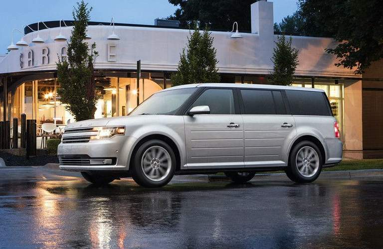 silver 2017 Ford Flex parked outside of garage
