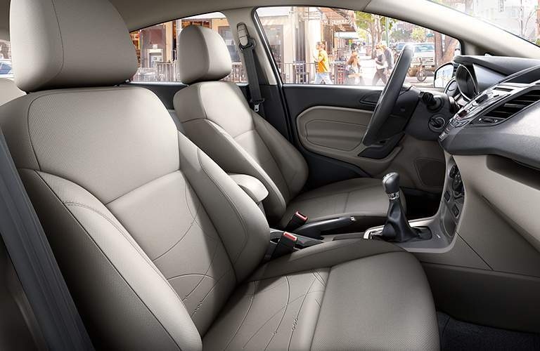 2018 Ford Fiesta driver and passenger seats from passenger door perspective, gray trim
