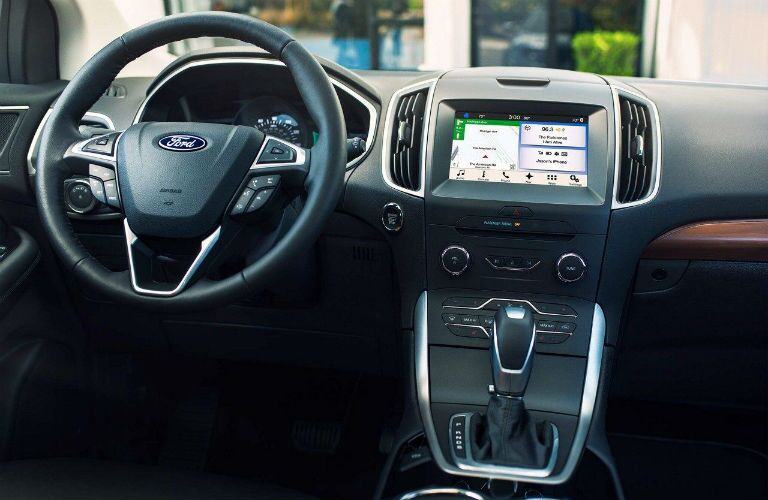 Close up on the infotainment system, console and steering wheel of the 2018 Ford Edge