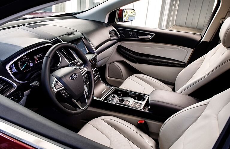 2019 Ford Edge interior front cabin with steering wheel dashboard and rotary dial shifting