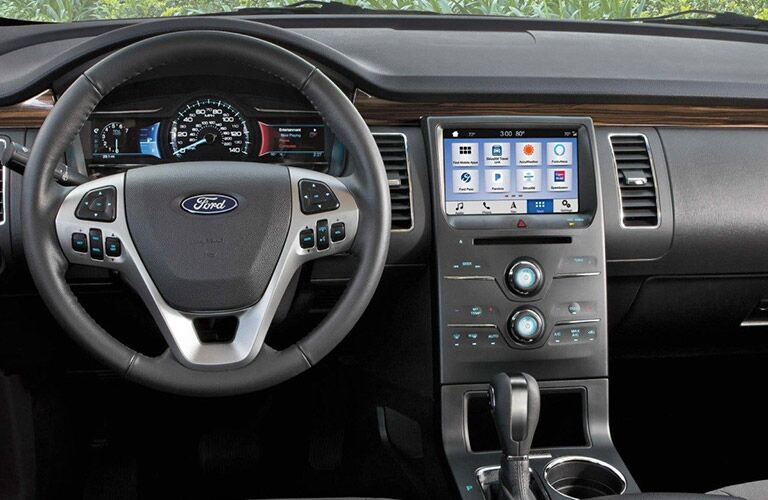 2019 Ford Flex interior front cabin close up of steering wheel touchscreen and partial dashboard