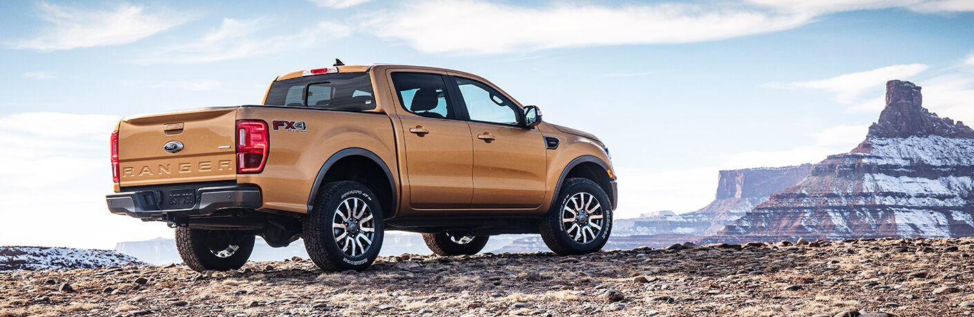 2019 Ford Ranger exterior back fascia and passenger side parked near craggy rock formation