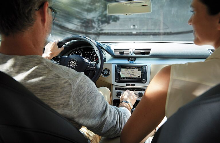 Couple in 2016 VW CC navigating with VW Car-Net App-Connect infotainment system
