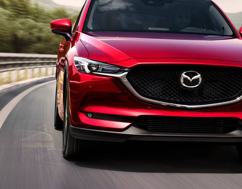 Front view of the 2019 Mazda CX-5 driving on a highway