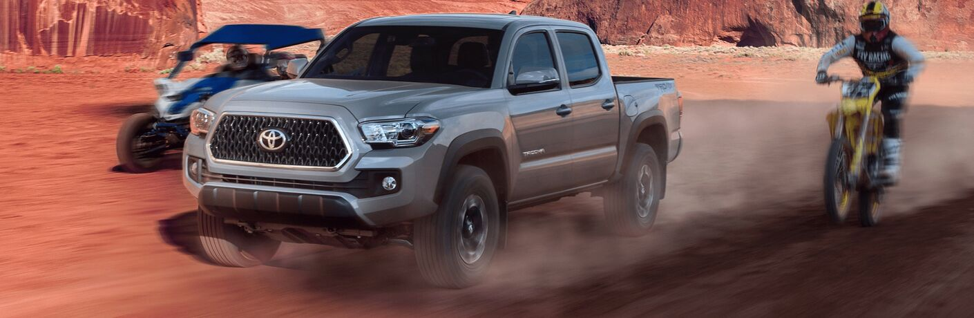 2019 Toyota Tacoma driving on the dirt road
