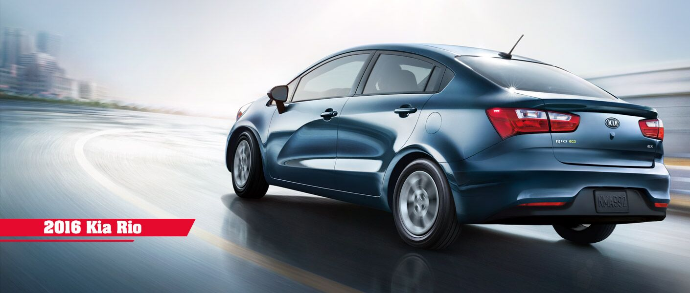 2016 Kia Rio Driving Down the Road