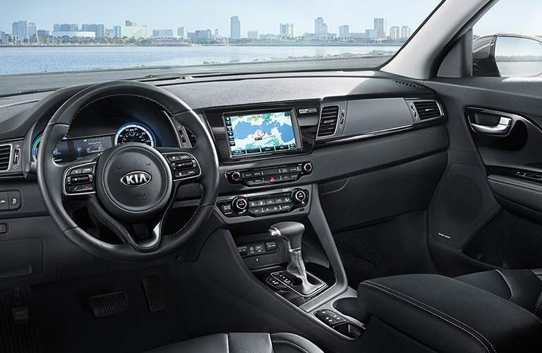 driver-side interior of 2108 kia niro including steering wheel and dashboard