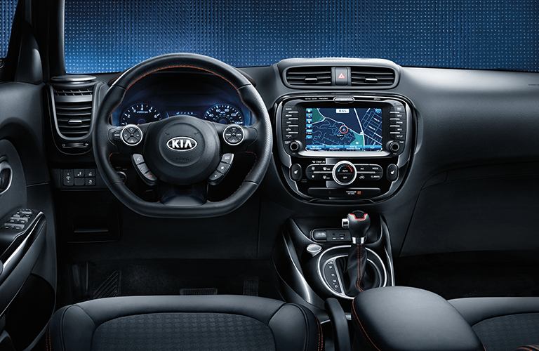 front interior driver view of 2018 kia soul steering wheel, windshield, dashboard, and center touch screen
