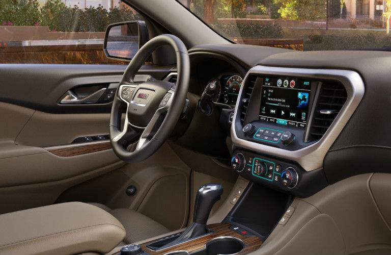 steering wheel and infotainment system of the 2017 GMC Acadia Denali