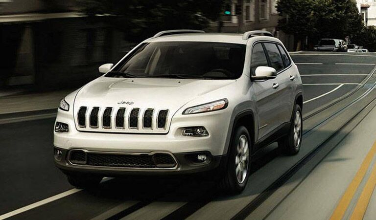 white 2016 Jeep Cherokee on the road
