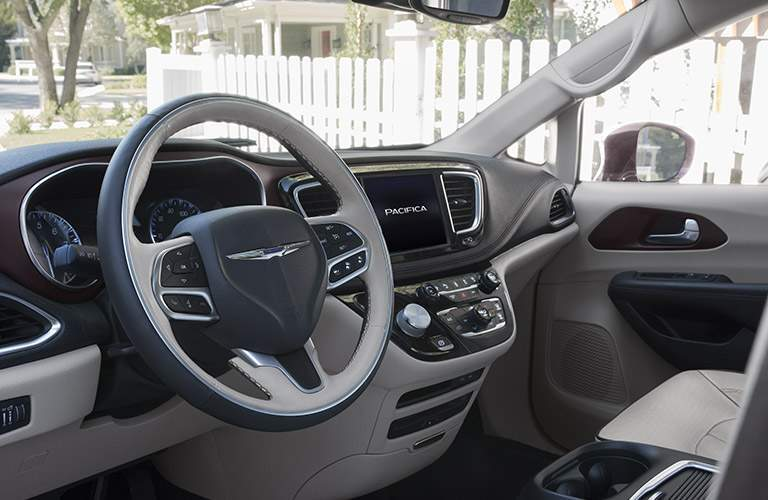 slightly side view of the steering wheel and infotainment system of the 2017 Chrysler Pacifica