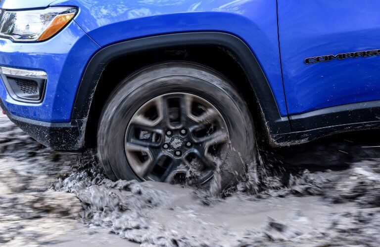 wheel close-up on the 2017 Jeep Compass while water fording