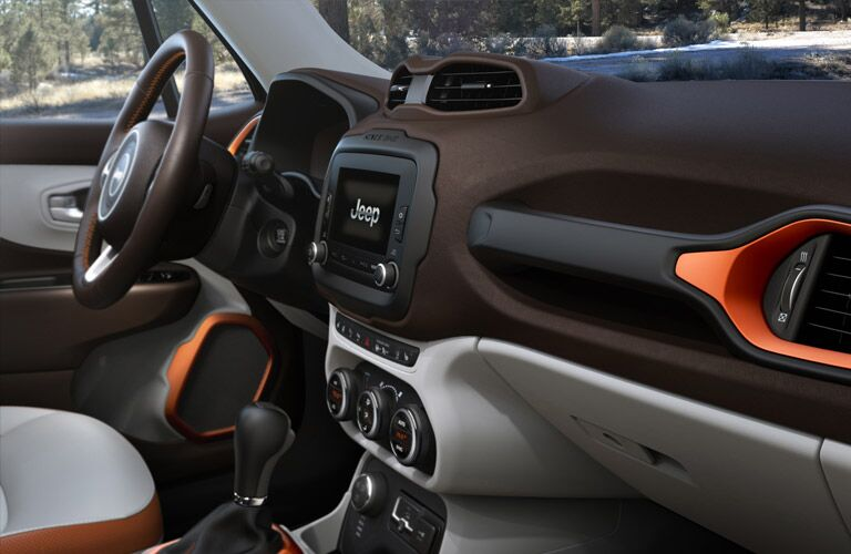 steering wheel and dashboard of the 2017 Jeep Renegade with orange accents