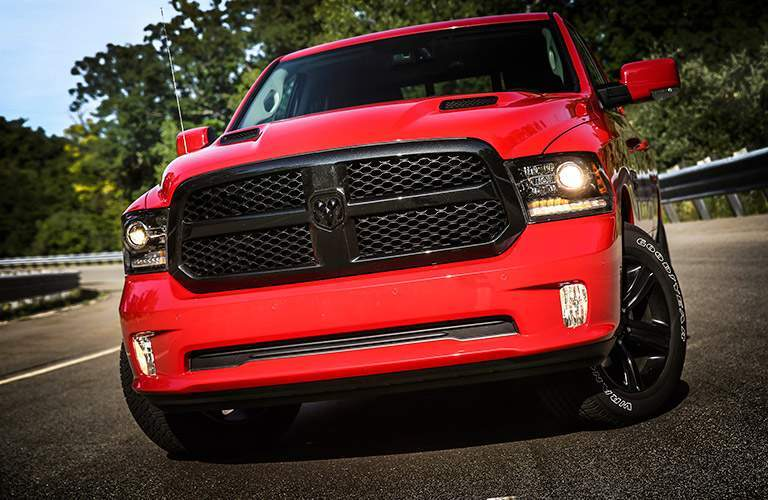 blacked out front grille of the 2017 Ram 1500 Night edition in red exterior paint