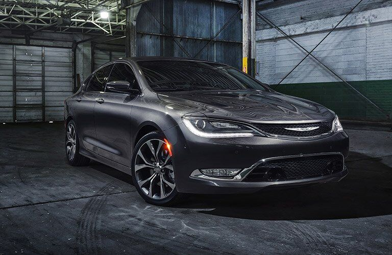 the Chrysler 200 is parked dramatically in a darkened warehouse