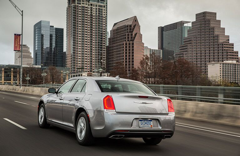 rear view of the 2017 Chrysler 300 against a city background