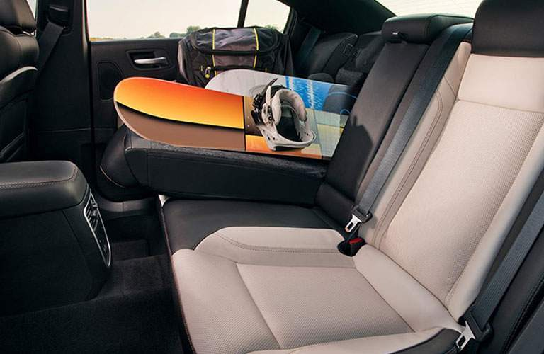 rear seats of the 2018 Dodge Charger with one section folded down to hold a snowboard