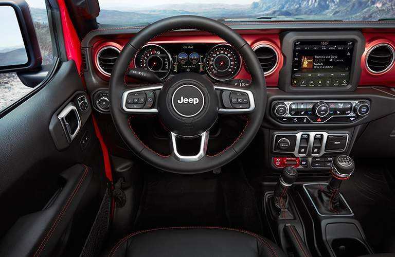 red-accented dashboard of the all-new 2018 Jeep Wrangler