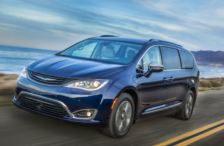 blue 2019 Chrysler Pacifica Hybrid on the road