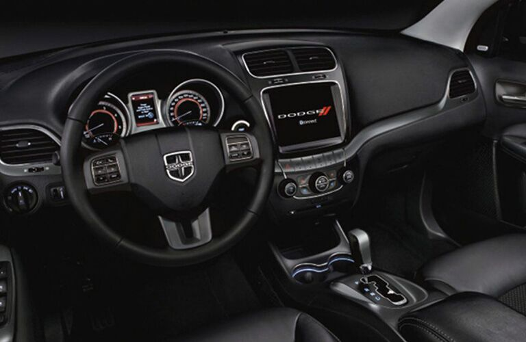 steering wheel and infotainment system of the 2019 Dodge Journey